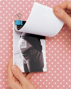 too cute! Watch your growing belly with a flip book - belly should always be shot in profile & on the same day each week. Write the week of pregnancy on a sticky note & place it on your stomach. Stack prints in sequential order & keep adding more, using binder clips to hold them together.