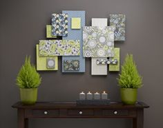 Wall art made from foam boards and scrap booking paper. Idea for mom's photo wall.