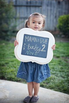pregnancy announcement photography by Jennifer Bagwell features chalkboard. I would say month and year instead of day I think