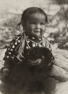 Native American Indian child and her dog.