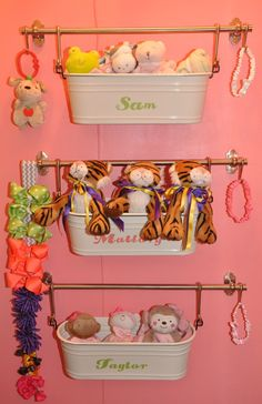 Clever storage in the closet: towel bar with hanging basket! #nursery #storage