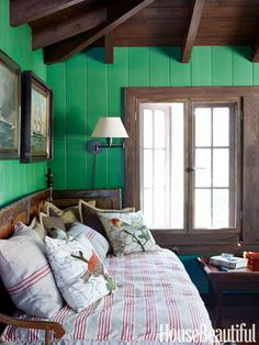 In the upstairs office, walls are painted leafy green to create the feeling of a tree house.