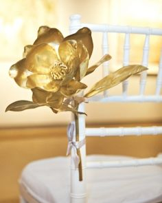Gilded magnolias - purchased in a crafts store and spray painted gold - aisle marker