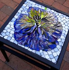 Pansy glass mosaic on wrought table by Judith