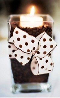 Coffee beans,then add a votive candle with a pretty ribbon..Instant cuteness!
