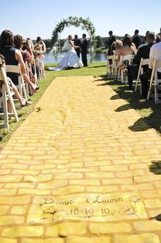 Hand painted yellow brick road aisle runner. Custom brick at end with wedding date Lauren's Wizard of Oz themed wedding. Wedding Dress and bridesmaids' corsets by Castle Corsetry Wizard Of Oz Wedding Ideas, Hand, Bridesmaids, Aisle Runners, Dream Come True, Castles, Bricks, Themed Weddings, Yellow Brick Road Aisle Runner
