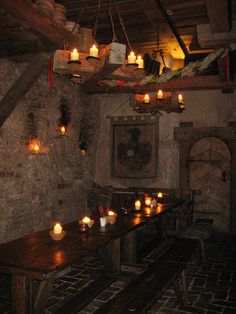 Atmospheric Basement of the Medieval Restaurant, Old Town, Riga, Latvia by Bencito the Traveller, via Flickr.  I like the stone walls, beamed ceiling, the plank door, the crest wall hanging, and the candle light.