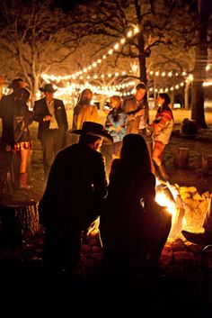 String lights between trees and get a campfire going for a summer camp theme wedding. Photography by Katherine O'Brien. #reception #summer #glamping