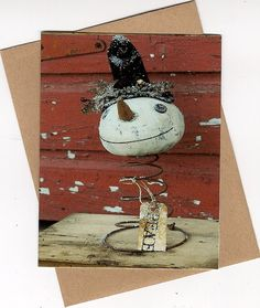 Prim Snowman...on an old rusty bed spring.