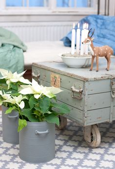 A trunk on wheels makes a cool coffee table.