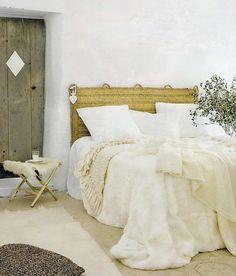 Beautiful Bedroom. Love the rustic door & the rattan Headboard. Love the white bedding & the mixtures of textures. Décor de Provence. Interior Design, Home Interiors, Home Decor