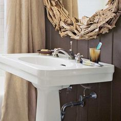 bath with accent wall covered in tongue and groove wood paneling painted in dark brown, easy budget bath upgrades