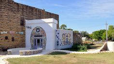 """""""Bowl Plaza""""- an eccentric, artistic 4 year project, 18' tall toilet tank, mosaic art work on the exterior and interior of the public restroom/art attraction. Designed and built under the supervision of the Grassroots Art Center. Submitted by Rosslyn Schultz, Executive Director."""