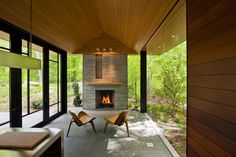 Nevis Pool and Garden Pavilion by Robert M. Gurney architect, interior, fireplaces, garden pavilion, outside fireplace, glass walls, contemporary gardens, pool garden, pool houses