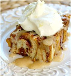 Pumpkin Pie Breakfast Bake is the perfect combination of pumpkin pie and cinnamon rolls, topped with buttery icing and ginger-spiked whipped cream.