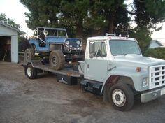 Old U-Haul hauling a jeep