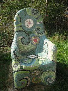 Mosaic chair  Started with a regular metal garden chair, covered it with chicken wire and concrete, and then added the mosaics.