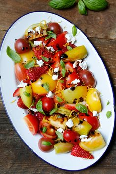 Strawberry Heirloom Salad with a sweet balsamic reduction -- skip the sprinkle of cheese at the end, and this makes a luscious Phase 1 side dish.