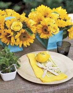 Use sunflowers as centerpiece and lemons as placecard