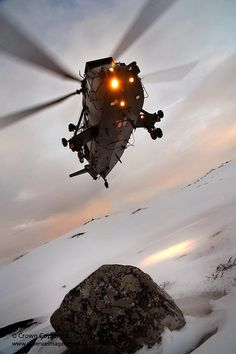 A Sea King HC Mark 4 helicopter from Commando Helicopter Force (CHF) conducts landing drills in the snow at Bardufoss, Norway.