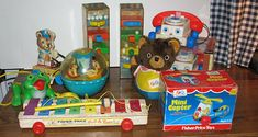 Fisher Price toys, I remember the Roly Poly Chime Ball with the rocking swans and horses, and the little Chatter Telephones! Their eyes moved when you pulled them along, I think!