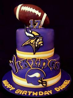 Minnesota Vikings Cake - Football is made of RKT covered with modeling Chocolate. Helmet, Logo and lettering 50/50 fondant gum paste mix. football cakes, footbal cake, gum paste, cake idea, minnesota vikings cake, vike cake, minnesota vike, football vikings cake, cake sport