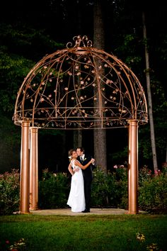 Hand-forged gazebo surrounded by roses and azaleas at Potomac Point Winery
