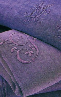 Lavender French linen decorated with embroidery.
