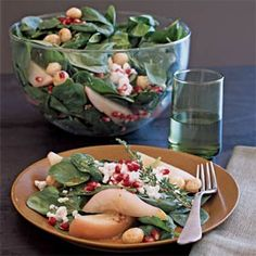 Poached Pear, Macadamia, and Spinach Salad with Goat Cheese | MyRecipes.com