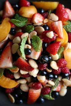 Strawberry, apricot, blueberry, and almond fruit salad with mint.