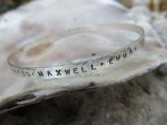 Personalized custom bangle, handstamped with your message, names, dates, or inspiration in sterling silver by JoDeneMoneuseJewelry on Etsy
