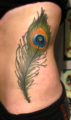 Peacock Feathers - great idea for a post mastectomy tattoo to cover scars- you can make the feather flow where ever your scars go.  ( p-ink.org )