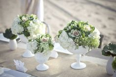 green and white centerpieces in milk glass