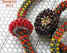 Bead Line Studios: The slider (and button shape) are Czech Twins and Duos.