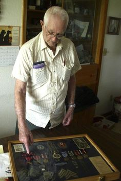 """Battle of the Bulge veteran Darrell Morris of Keosauqua says some of the medals he earned in World War II didn't come until 50 years later. He'd never asked for them or anything else from the government. Read his story at the link - he was recently diagnosed with PTSD. """"I fight Germans every night,"""" he said."""