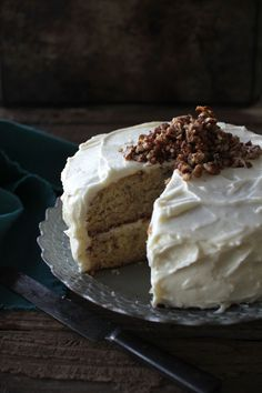banana cake with cream cheese icing and brown butter pecans.