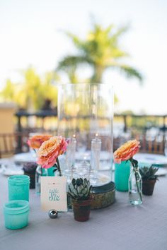 #table-numbers, #centerpiece, #candle  Photography: Daniel Lateulade - daniellateulade.com  Read More: http://www.stylemepretty.com/2014/07/21/coral-aqua-whimsical-garden-wedding/