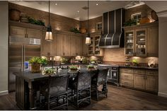 Kitchen: dark wood cupboards and black accents