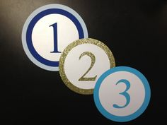 #TABLECARDS IN THE #ROUND...  Recently we have created a series of #laser cut #round #tablecard numbers to accompany the #round #menus that fit neatly into table chargers. This photo shows the beauty of layering different papers in different sizes for your table display. Give us your best ideas for great laser cut table numbers???