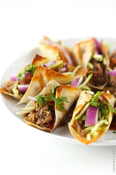 Hawaiian BBQ Pork Wonton Tacos by cremedelacrumb: Sweet n' saucy slow cooked Hawaiian BBQ pork wrapped in wonton wrappers and baked til crispy! All topped with the most amazing sauce!  #Tacos #Pork #Wonton #Slow_Cooker