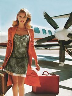 Hello gorgeous! Go retro glam next time you travel with big curls and a bright red lip.