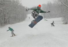 Josh Renz of Bismarck catches some air on a jump and makes it look easy while riding at Huff Hills Ski Area. Huff is celebrating its 20th anniversary this weekend.
