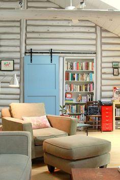 blue barn door slider in log cabin