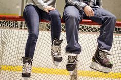 Hockey couple sitting on a net. I'd like wedding photo's like this! :)