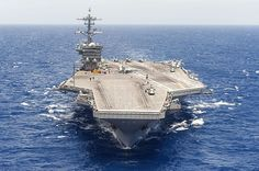 The aircraft carrier USS Theodore Roosevelt (CVN 71) transits the Atlantic Ocean.