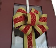 DIY large bow.  Christmas decorations.  Indoor outdoor ribbon.  How to make a large bow to decorate your front door wreath or banister for the holidays.  Extra wide wired ribbon.