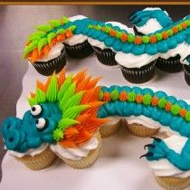 Dragon cupcake cake decorated by Leslie Schoenecker at Walmart.