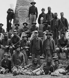 Soldiers in front of monument at Bull Run Battlefield, Virginia. (June 10, 1865).