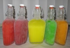 Skittle infused Vodka....8 oz of Vodka, 60 skittles in each bottle to sit over night. YUM.