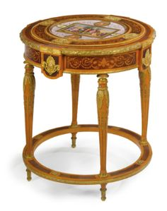 A GILT BRONZE MOUNTED SATINWOOD, MAHOGANY AND PURPLEWOOD CIRCULAR CENTER TABLE Austria, circa 1890s